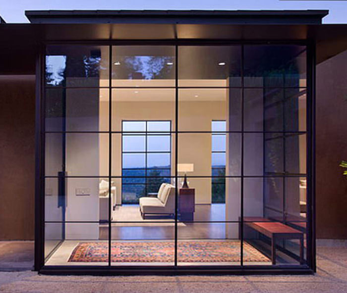 Modern steel windows and doors in a luxury villa with pool.